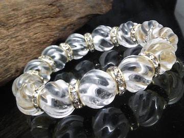 トルネード水晶14ミリ金ロンデル数珠