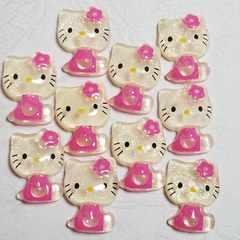 A ☆ 10コ ☆ (ピンク) ラメ入り お座り 横向き キティ  約2cm ☆ デコパ