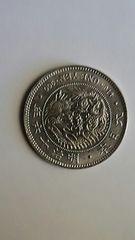 新1円銀貨(明治16年)レプリカです。