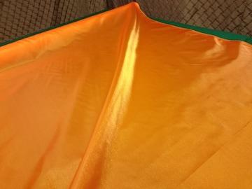 (No.1059)約110�p幅×1m・オレンジ系ナイロンツインクルサテン